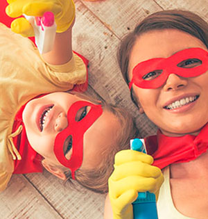 woman and child sitting on the floor wearing red masks